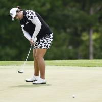 Feng Shanshan Feng putts on the fifth hole in the first round of the U.S. Women's Open at Trump National Golf Club in Bedminster, New Jersey, on Thursday. | USA TODAY / VIA REUTERS