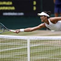 Muguruza crushes Rybarikova to book spot in Wimbledon final