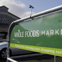 A Whole Foods Market is seen in June in San Antonio, Texas. Whole Foods shareholders voted Wednesday, to bless a $13.7 billion union with Amazon that the organic grocery chain's CEO had called 'love at first sight.' By buying Whole Foods, Amazon will get more than 460 stores and potentially very lucrative data about how shoppers behave offline. | AP