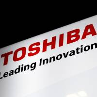 Toshiba Corp.'s company logo is seen at JR Hamamatsucho Station in Minato Ward. Toshiba President Satoshi Tsunakawa will hold a news conference Thursday to explain the firm's financial statement. | SATOKO KAWASAKI .