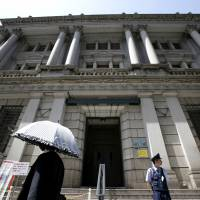 Takahide Kiuchi, who recently stepped down from the Bank of Japan's Policy Board, says the central bank is adding to the risks of its aggressive monetary easing policy by discussing only the potential upside. | AP