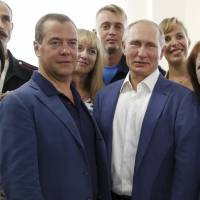 Russian President Vladimir Putin and Russian Prime Minister Dmitry Medvedev are seen together during their visit to Sevastopol, Crimea, on Aug. 18. | AP