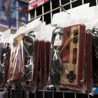 Controllers for the Nintendo Entertainment System / Famicom console are displayed for sale at the Super Potato video game store in Akihabara, Tokyo, on Aug. 8.   BLOOMBERG