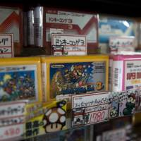 Video games cartridges for Nintendo's Famicom console are displayed for sale at the Super Potato video game store in the Akihabara.   BLOOMBERG