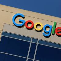 The Google logo is seen atop an office building in Irvine, California, Monday. | REUTERS