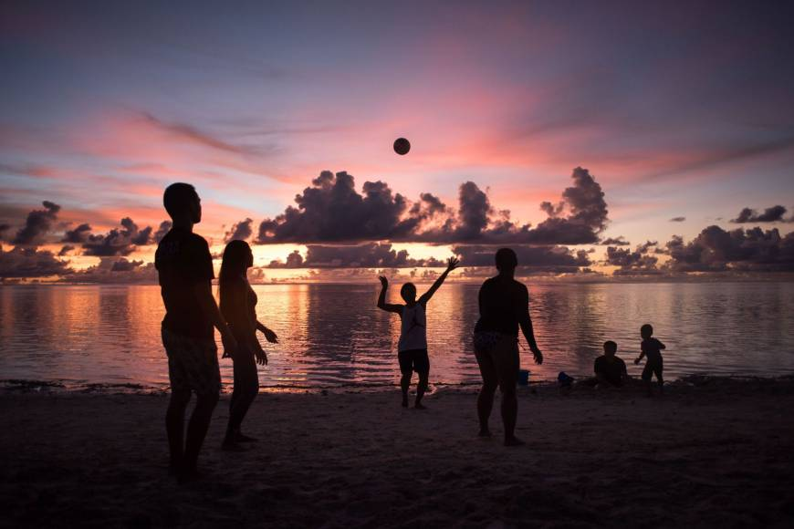 This photograph taken on Saturday shows volleyball players on a beach at Tumon Bay on Guam. | AFP-JIJI