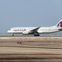A Qatar Airways plane takes off July 20 from the Hamad International Airport in Doha. Saudi Arabia on Sunday said Qatar had refused to allow its planes to land in Doha to transport Qatari Muslims to Mecca for the annual hajj pilgrimage. | AFP-JIJI