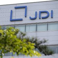 Japan Display Inc. is reportedly considering slashing around 4,000 jobs, mostly at overseas factories. | BLOOMBERG