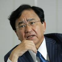 Yoshimitsu Kobayashi, chairman of the Japan Association of Corporate Executives, says Prime Minister Shinzo Abe should go ahead with the planned sales tax hike in October 2019 to address Japan's ballooning debt. | BLOOMBERG