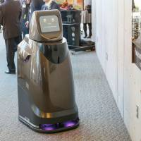Panasonic Corp.'s Hospi robot can deliver drinks to customers and clear away dishes from tables at airports and hotel lobbies. | PANASONIC CORP. / VIA KYODO