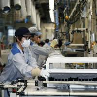 Japanese industrial output slipped in July on shrinking inventories