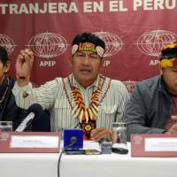Amazonia community leaders (from left) (Apus in their native language) Alfonso Lopez, Aurelio Chino and Carlos Sandia meet with the foreign press in Lima on Tuesday. Amazonia leaders are holding dialogue sessions with Peruvian government officials on the ecological damage and health hazards that oil exploitation in their territories bring. The central issue for the leaders is the prior consultation to their community leaders before the government bids for exploitation in their territory. | AFP-JIJI