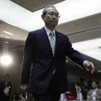 Toshiba Corp. President Satoshi Tsunakawa arrives last Thursday for a press conference in Tokyo, after the company's auditors signed off on its full-year earnings. | BLOOMBERG