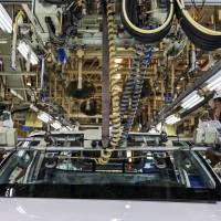 Workers assemble a car at a Toyota Motor Corp. plant in Ban Pho, Chachoengsao province, Thailand.   BLOOMBERG