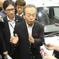 Toyota Motor Corp. Chairman Takeshi Uchiyamada speaks to reporters in the city of Chiba on Friday. | KYODO