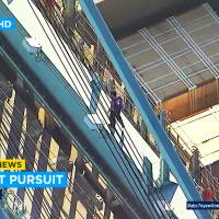 Suspected car thief chased by police climbs crane, strips and falls to death in Los Angeles