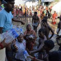Two-week death toll from South Asia flooding tops 1,000