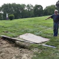 At New Jersey burial for family patriarch, rotting foot from adjoining grave falls on coffin