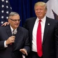 Critics cry racism as Trump weighs Arpaio pardon on heels of tardy rebuke of white supremacists