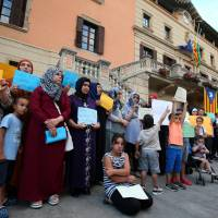 Relatives of suspects of the attacks in Barcelona and Cambrils gather with members of the local Muslim community as they take part in a rally to denounce terrorism in front of Ripoll's townhall, Spain, Sunday. | REUTERS