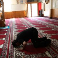 A man prays last Saturday at the mosque where imam Abdelbaki Es Satty preached in Ripoll, north of Barcelona, Spain. | REUTERS
