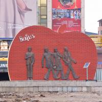 A statue of the Beatles stands amid construction work in front of a shopping center in Ulaanbaatar on Wednesday. | REUTERS