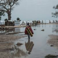A woman stands in a pool of rain water in Rann in northeast of Nigeria close to the Cameroonian border on Saturday. | AFP-JIJI