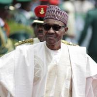 Nigeria's President Buhari, abroad three months over illness, says he is OK