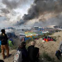 France to set up two centers to handle migrants returning to Calais seeking way to U.K.