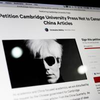 A computer screen shows an online petition page urging Cambridge University Press to restore more than 300 politically sensitive articles removed from its website in China after a request from authorities, in Beijing on Monday. | AP