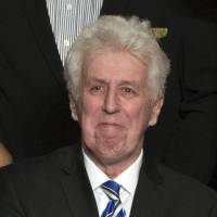 CNN commentator Jeffrey Lord appears at a rally for President-elect Donald Trump in Hershey, Pennsylvania, last December. CNN cut ties Thursday with Lord, a conservative commentator, after he tweeted a Nazi salute at a critic. | AP