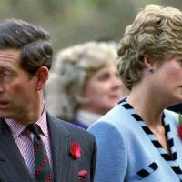 Britain's Princess Diana and Prince Charles look in different directions during a Korean War commemorative service in November 1992.   REUTERS