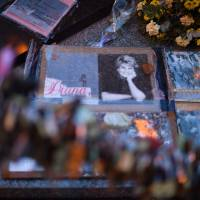 Photographs of Diana, Princess of Wales, are seen on Wednesday with floral tributes left over the Alma bridge in Paris to mark the coming 20th anniversary of the death of Diana, who died in a car crash in a nearby tunnel on Aug. 31, 1997. | AFP-JIJI