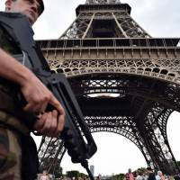 Eiffel Tower attack suspect says he was in touch with Islamic State member