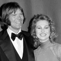Country singers Glen Campbell and Tanya Tucker, engaged to one another, are shown at the Grammy Awards in Los Angeles in 1979. Campbell, the grinning, high-pitched entertainer who had such hits as 'Rhinestone Cowboy' and spanned country, pop, television and movies, died Tuesday. He was 81. Campbell announced in June 2011 that he had been diagnosed with Alzheimer's disease. | AP