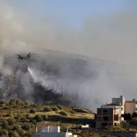 Greece battles big brush fire south of Athens