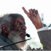 Comic, rights activist Dick Gregory dies at 84