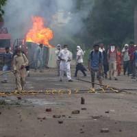 Indian guru convicted of raping followers; protesting mobs kill dozens