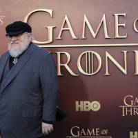 Co-executive producer George R.R. Martin arrives for the season premiere of HBO's 'Game of Thrones' in San Francisco in 2015. | REUTERS