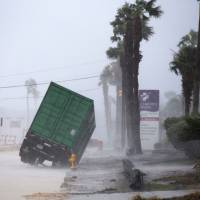 Hurricane Harvey weakens to Category 1 after slamming into Texas