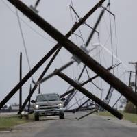 Hurricane Harvey churns deeper into Texas but loses force; at least one dead but full scope of damage unknown