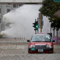Waves triggered by Typhoon Hato batter Hong Kong's shoreline on Wednesday. | REUTERS