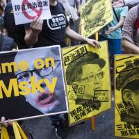Thousands join protest in Hong Kong over jailing of young democracy activists