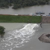 Residents urged to 'GET OUT NOW!!!' as Houston dams, levee overflow; flood death toll now at three