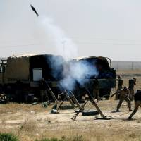 Members of Iraqi Army fire mortar shells during the war between Iraqi army and Shiite Popular Mobilization Forces (PMF) against the Islamic State militants in al-Ayadiya, northwest of Tal Afar, Iraq, Monday. | REUTERS