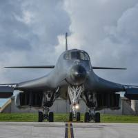 A U.S. Air Force B-1B Lancer assigned to the 37th Expeditionary Bomb Squadron prepares to take off from Andersen Air Force Base, Guam, for a 10-hour mission, flying in the vicinity of Kyushu, the East China Sea and the Korean Peninsula Monday. | RICHARD P. EBENSBERGER / U.S. AIR FORCE / VIA AFP-JIJI