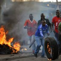 At least four dead in Kenya violence after disputed poll; hacking denied