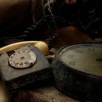 A rotary dial telephone set and clock are seen in the NATO tunnels dating back to the Cold War in the War Headquarters tunnels beneath Valletta in March. | REUTERS