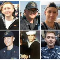 U.S. Navy confirms one dead in McCain collision, calls off sea search for nine others missing