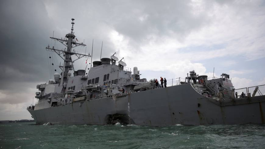 U.S. Navy to probe Japan-based fleet as hunt for sailors missing in latest collision continues